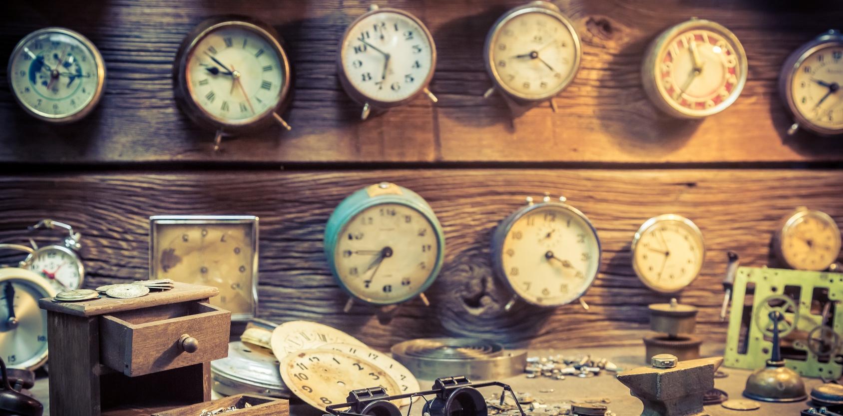 Old watchmaker's room full of clocks